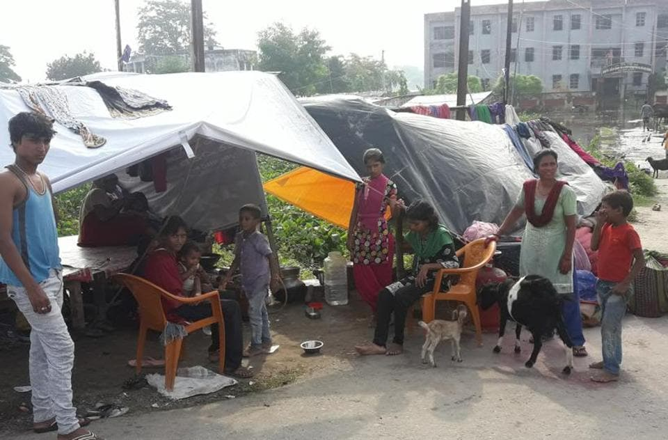 Flood affected people take shelter on national highway-28 near Bariyarpur in East Champaran district of Bihar.