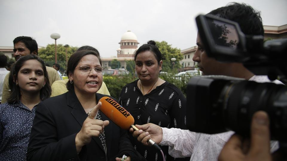 Farha Faiz, a Supreme Court lawyer, speaks to the media after the apex court declared
