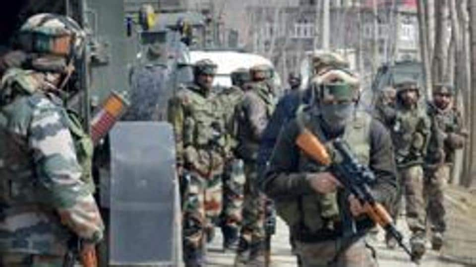 Army personnel move towards the house where militants were hiding, during an encounter in Pulwama district of south Kashmir.