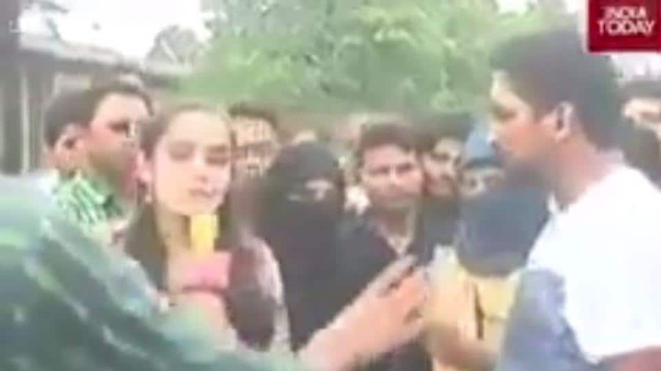 A reporter and a camera person were heckled and hurled abuses at by a group of men at the Aligarh Muslim University on Tuesday.