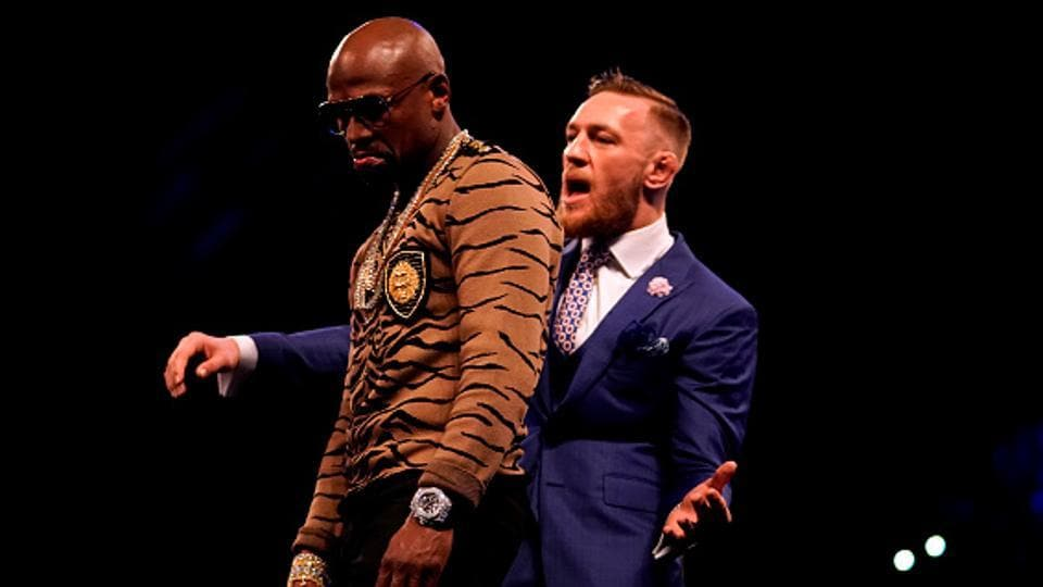 Conor McGregor taunts Floyd Mayweather Jr. during one of the World Press Tour events building up to the big fight.