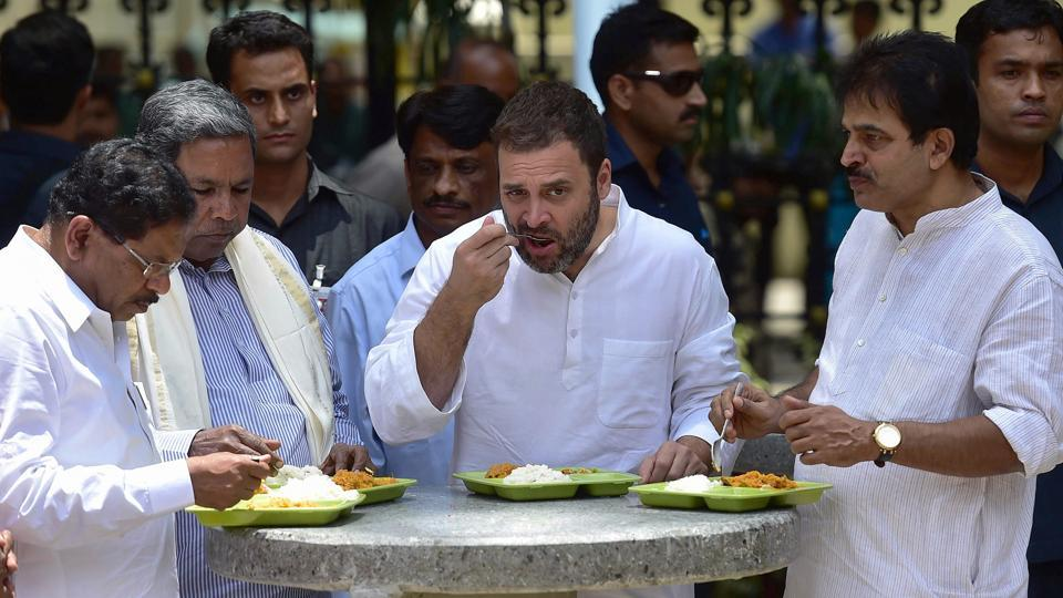 Congress Vice President Rahul Gandhi, Karnataka Chief Minister Siddaramaiah, state minister G. Parameshwara and senior Congress leader Venugopal taste the food after opening the subsidised eatery