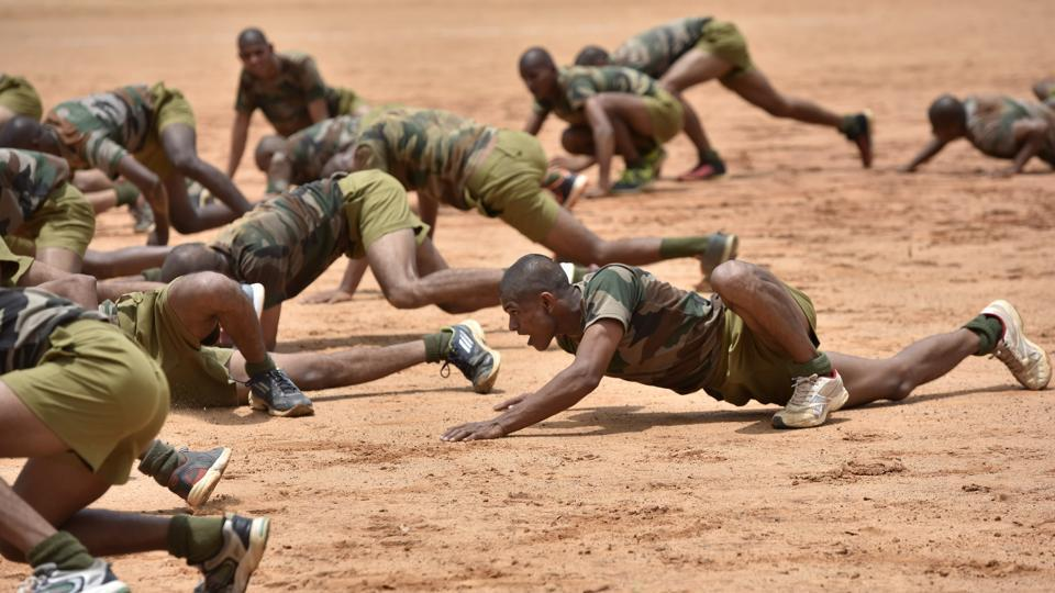 Parachute regiment recruits perform a crocodile walk during a training session. Members of the regiment are selected on the basis of performance efficiency, physical and mental agility as well as preference towards youth. Only those among the armed forces with less than five years of service, 'Shape-I' medical fitness and 'Excellent' Battle Physical Efficiency Tests results are considered eligible to volunteer for the regiment.  (Arijit Sen / HT Photo)