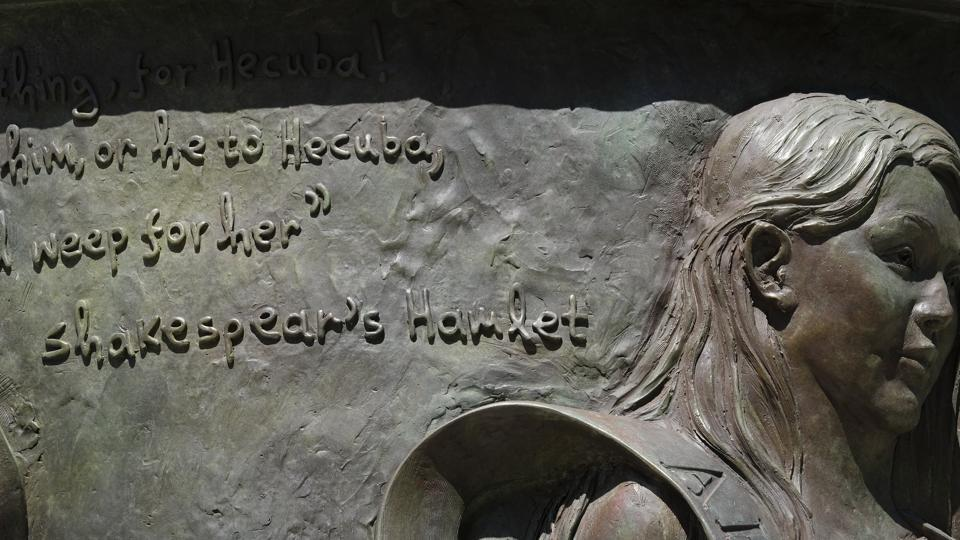 A statue of the legendary queen of Troy with a quote by William Shakespeare with the name spelled