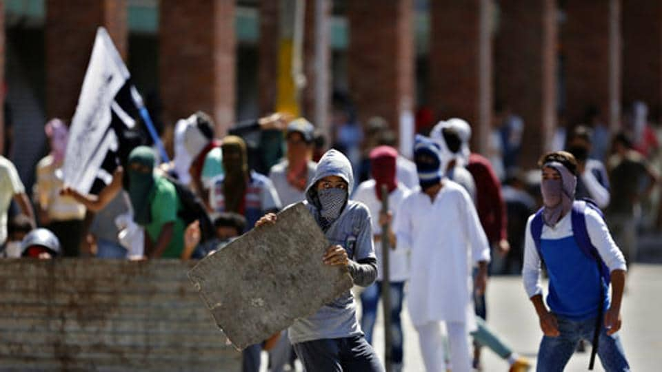 Masked Kashmiris participate in a protest in Srinagar, Indian controlled Kashmir on  August 18.