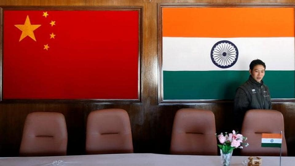 A man walks inside a conference room used for meetings between military commanders of China and India, in Arunachal Pradesh, November 11, 2009.