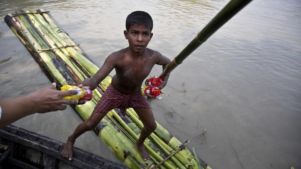 Successive waves of floods have wreaked havoc in the state of Assam, breaching the banks of the Brahmaputra inundating the low lying plains in the valley. Reeling with the aftermath, rickety boats and rafts often made from banana trunks held together by ropes are the only resort for those affected. From rescue and medical relief to even temporary schools, boats are the only means of getting by before floodwaters recede and normalcy is re-established. (Anupam Nath/AP)