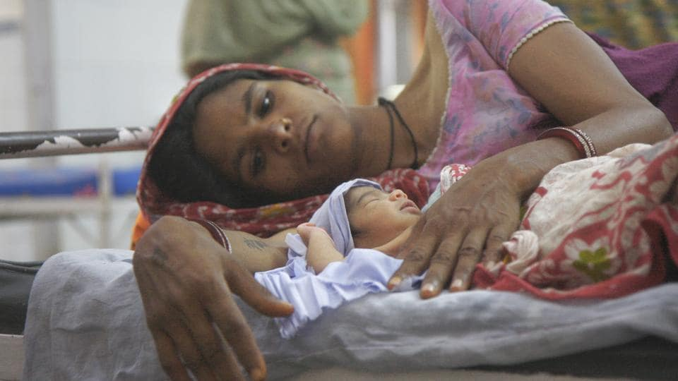 A mother with her newborn daughter at a government hospital in Rajasthan.