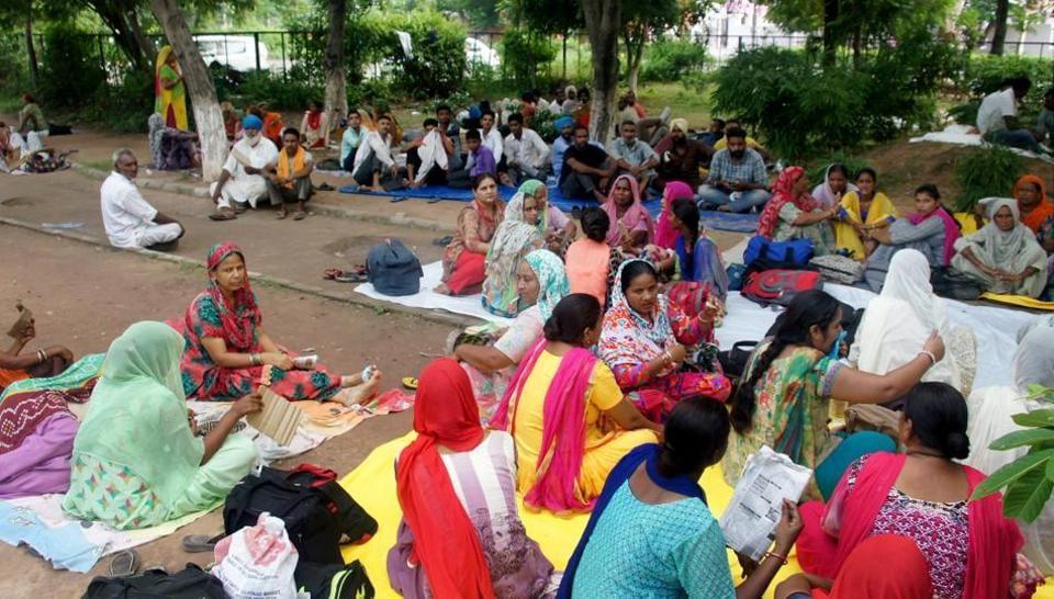 Followers of Dera Sacha Sauda chief Gurmeet Ram Rahim gather at a park in Panchkula on August 24. Photo credit: PTI