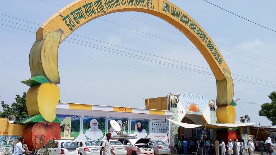 The main gate of the Dera Sacha Sauda in Sirsa. Dera chief Gurmeet Ram Rahim Singh has been convicted in a rape case. (HT Photo / Manoj Dhaka)