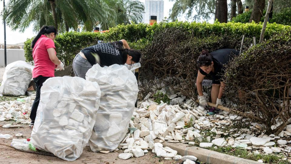 Residents and government workers pick up polystyrene and other rubbish in Heng Fa Chuen in Hong Kong. Macau's leader Fernando Chui had requested the Chinese army's involvement in 'disaster relief' after the highest category 10 Typhoon Hato pummelled the worlds biggest gambling hub. (Jayne Russell / AFP)