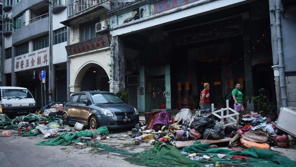 According to Chinese news agency Xinhua at least 27,000 people were evacuated to emergency shelters, while heavy rain and high tides caused extensive damage to farmlands. Macau's leader Fernando Chui said, 'Hato is the strongest typhoon in 53 years and has brought tremendous damage to Macau.' (Antony Wallace / AFP)