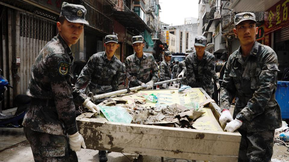 Chinese People's Liberation Army troops were deployed onto the streets of Macau on Friday to help clean up in the aftermath of a devastating typhoon. Macau public broadcaster TDM reported some 1,000 Chinese PLA troops left their Macau barracks to assist in the recovery. Chinese troops are rarely seen on the streets of Macau. (Tyrone Siu / REUTERS)