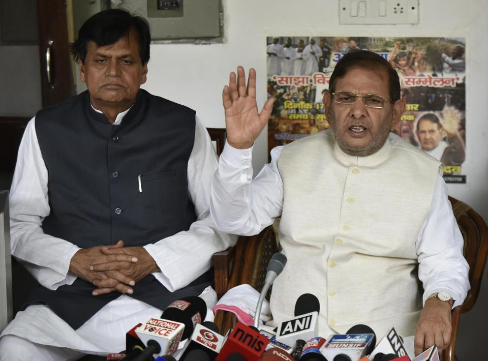 Sharad Yadav with Ali Anwar during a press conference at his residence in New Delhi on August 16.