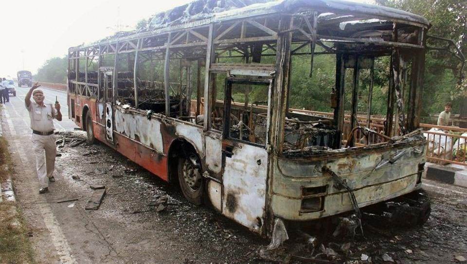 A DTC bus that was set on fire by followers of Dera Sacha Sauda chief Gurmeet Ram Rahim after he was conviction for rape, in New Delhi on  August 25, 2017.