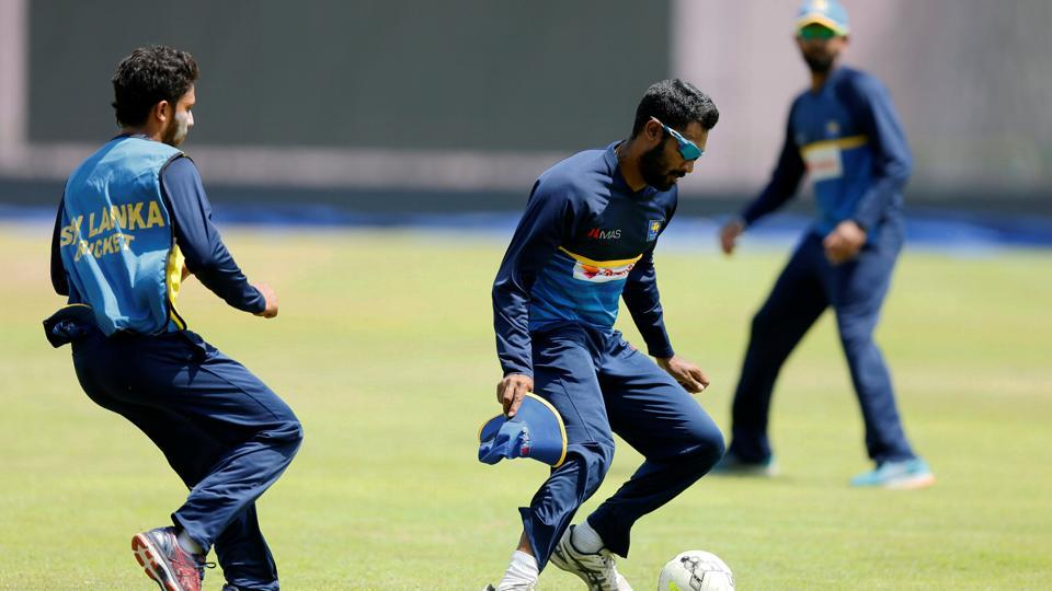 Chamara Kapugedera and his teammate Kusal Mendis have an intense training session. (REUTERS)