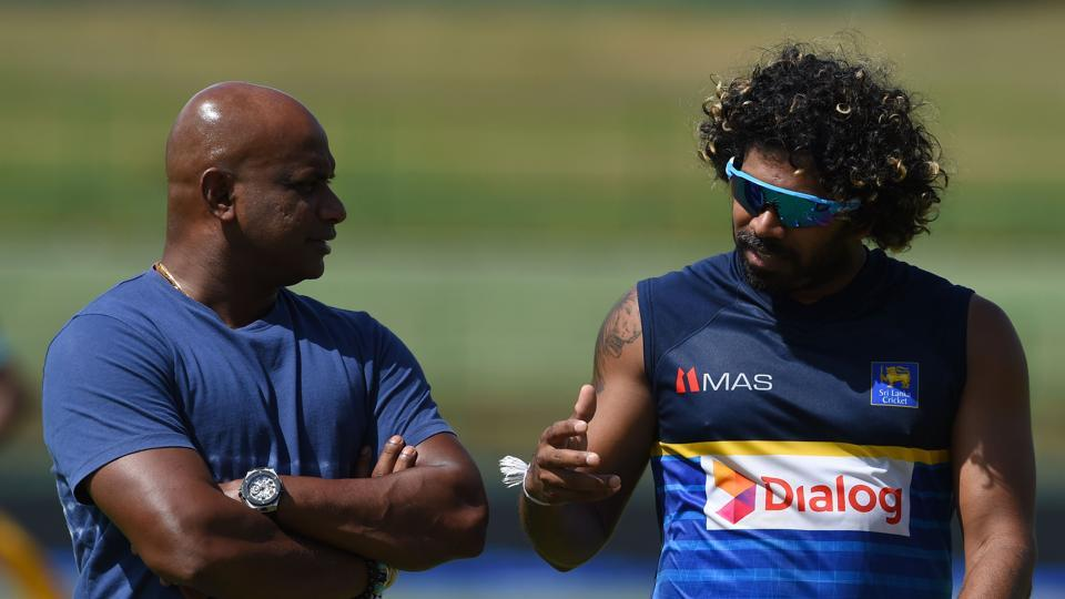 Lasith Malinga (L) speaks with chairman of selectors Sanath Jayasuriya during a practice session as the hosts aim to stay alive. (AFP)