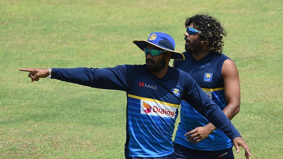 Chamara Kapugedera (L), who will captain Sri Lanka for the third ODI and Lasith Malinga (R) take part in a practice session. (AFP)