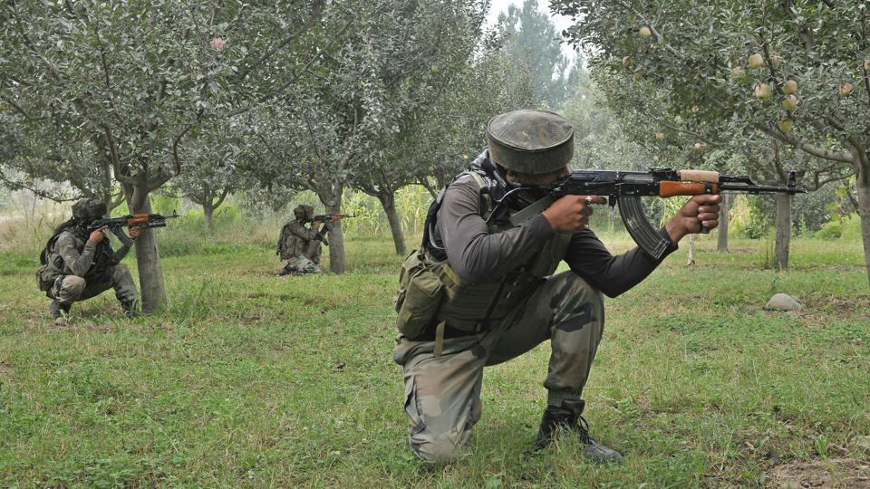 Army soldiers take position near the site of gunfight at district police lines in Pulwama on Saturday.