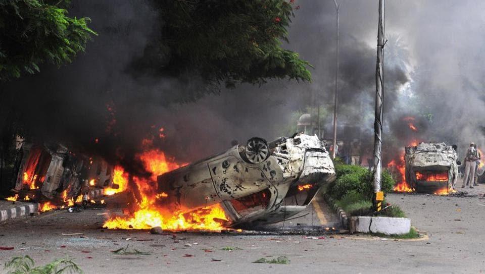 Followers of Dera Sacha Sauda chief Gurmeet Ram Rahim Singh set vehicles on fire after the controversial guru was convicted of rape in Panchkula.