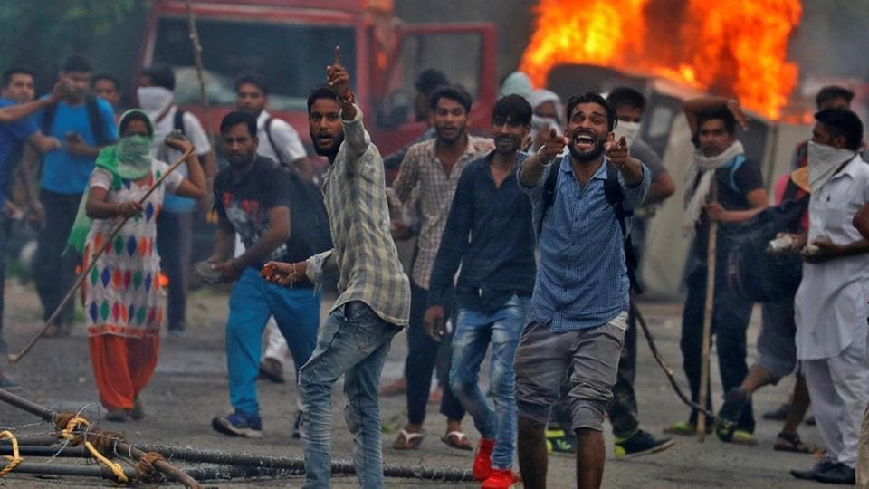 Supporters of Gurmeet Ram Rahim's Dera Sacha Sauda react during the violence in Panchkula, on August 25, 2017.