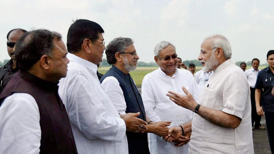 Prime Minister Narendra Modi with Bihar Chief Minister Nitish Kumar and Deputy Chief Minister Sushil Kumar Modi at Paurnea Airport on Saturday.