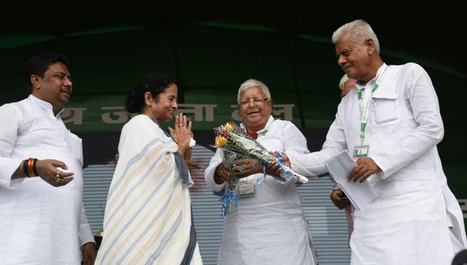 West Bengal chief minister Mamata Banerjee is being welcomed at the RJD rally as Lalu Prasad looks on, in Patna on Sunday.