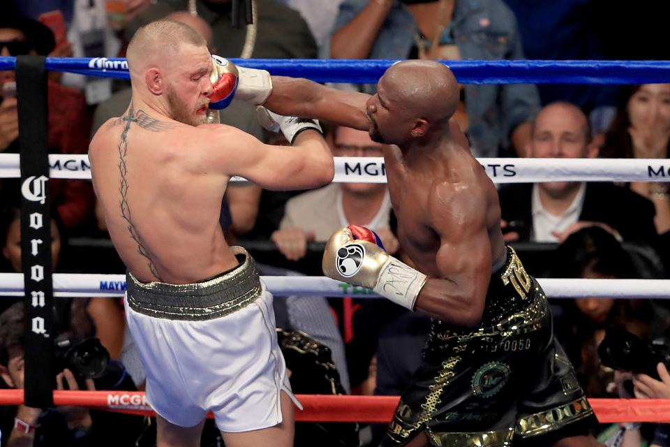Floyd Mayweather (R) needed 10 rounds to beat Conor McGregor in their super fight at the T-Mobile Arena in Las Vegas Saturday night.
