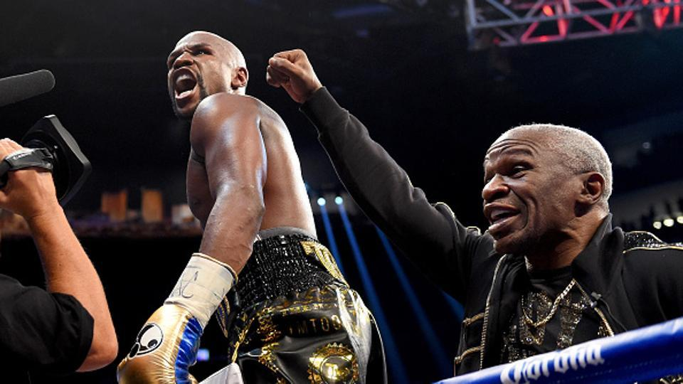 With the win, Mayweather extended his career record to 50-0.  (Zuffa LLC via Getty Images)