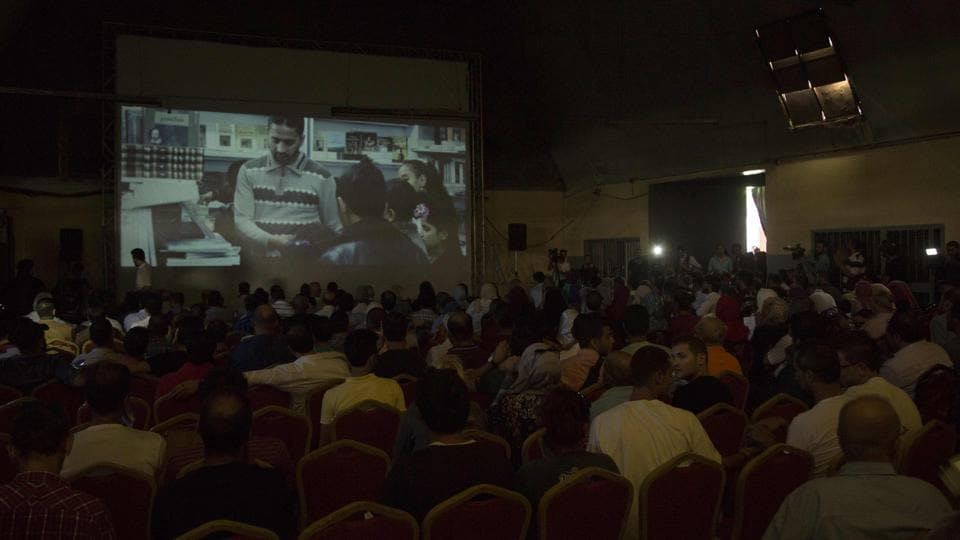 Palestinians attend the screening of 10 Years at Samer Cinema in Gaza City on August 26.