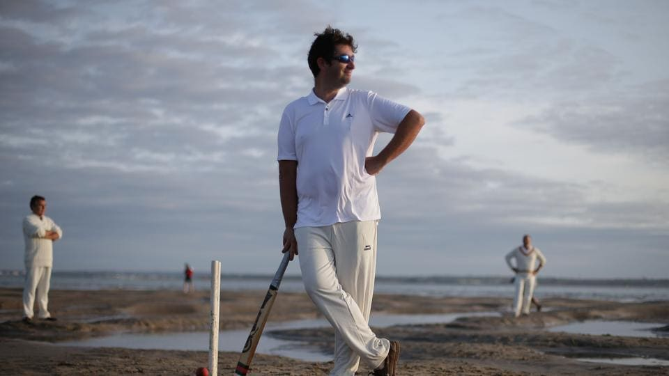 Cricket players from the Royal Southern Yacht Club and Cowes Island Sailing Club play an annual cricket match in the middle of The Solent, on the Brambles sandbank which appears for a short period of time at low tide, on August 24, 2017. The match takes place between the Royal Southern Yacht Club and Cowes Island Sailing Club. Boats transport players and spectators from the Isle of White and Southampton.  (Daniel Leal Olivas/ AFP)