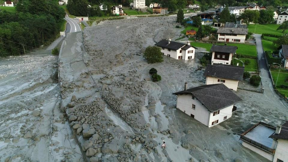 Aerial video grab made on August 24, 2017 partially shows the Switzerland village of Bondo after a landslide struck the day before, sending mud, rocks and dirt flooding down the Piz Cengalo mountain into the outskirts of the village, near the Italian border. (AFP)