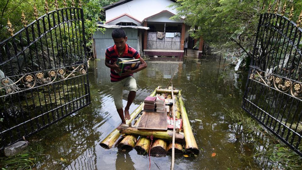 A boy uses a banana raft to transport his books in Jakhalabandha area in Nagaon district, in the northeastern state of Assam. (Anuwar Hazarika /REUTERS)