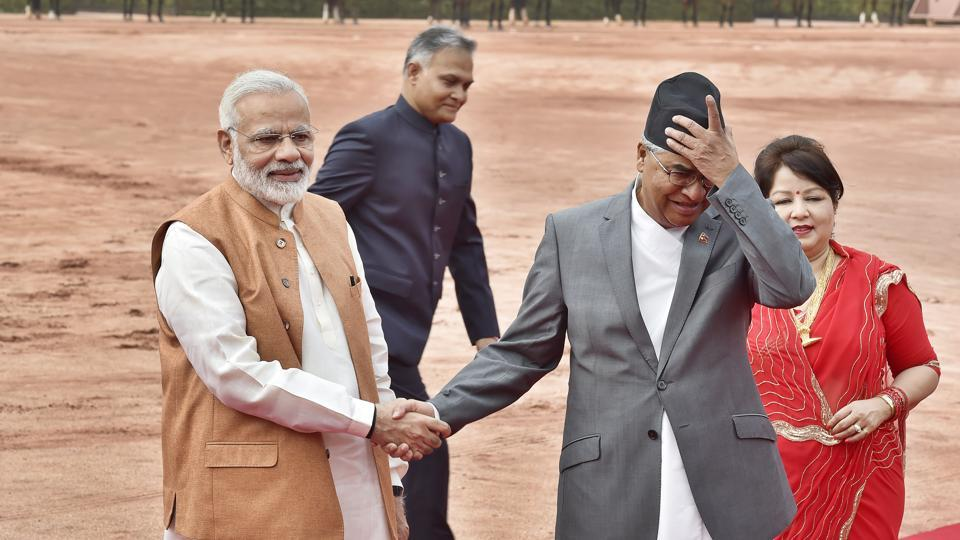 Prime Minister Narendra Modi shake hands with Nepalese Prime Minister Sher Bahadur Deuba while his wife Dr. Arzu Rana Deuba looks on during his ceremonial reception at Rashtrapati Bhavan in New Delhi  on Thursday. (Ajay Aggarwal/HT PHOTO)