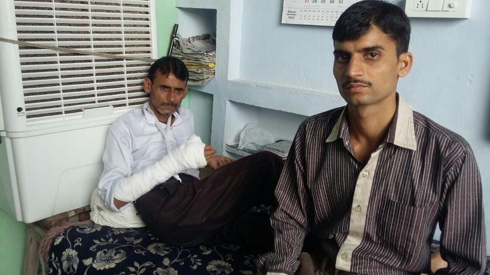 Ashish Chaturvedi (right) alleged his father was hit by a car in Gwalior.