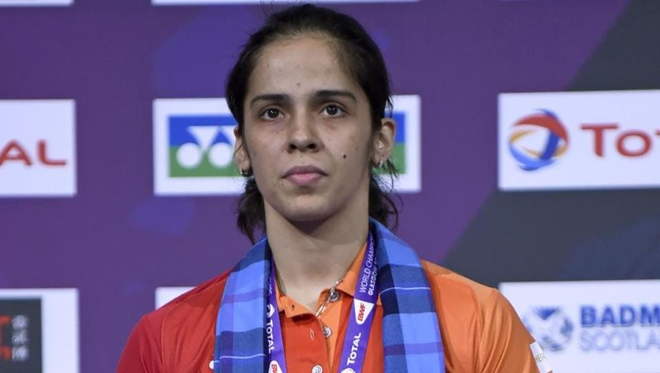 India's Saina Nehwal poses with her bronze medal on the podium for the women's singles during the 2017 BWF World BadmintonChampionships at the Emirates Arena in Glasgow on Sunday.