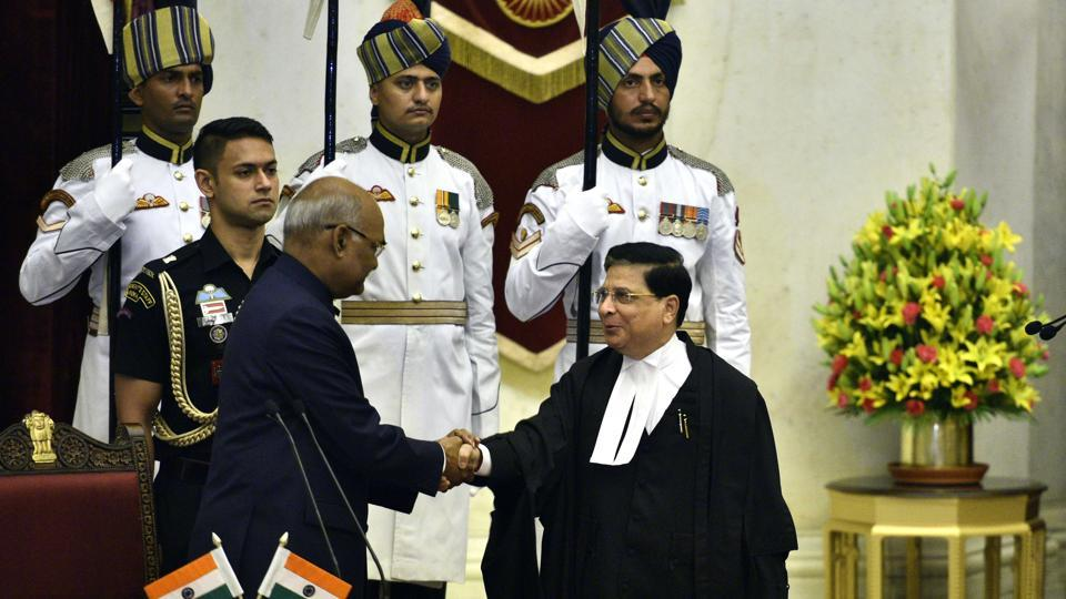 President Ram Nath Kovind congratulates Justice Dipak Misra as he takes oath as the 45th Chief Justice of India in New Delhi, India.