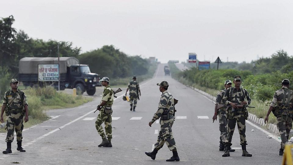 Haryana and Punjab brace anticipatorily with the deployment of thousands of riot police, setting up a five-tier cordon around Rohtak jail, shutting mobile internet services, schools and colleges. CBI judge Jagdeep Singh  sentenced 'godman' Gurmeet Ram Rahim Singh to 20 years in jail. The Dera chief's followers went on rampage after he was convicted of rape on Friday. Rohtak district has been cordoned off by paramilitary forces and Haryana Police with the army on standby. (Kamal Singh / PTI)