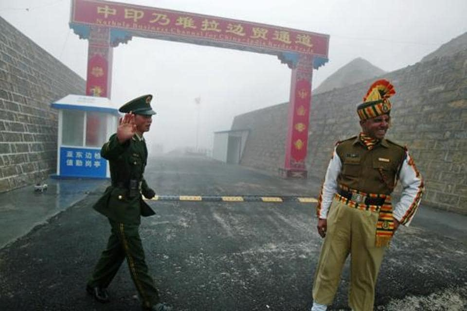 This 2008 file photo shows a Chinese soldier (L) next to an Indian soldier at the Nathu La border crossing between India and China in India's northeastern Sikkim state.