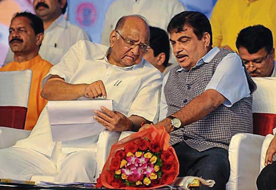 Union Minister Nitin Gadkari (Left) and Sharad Pawar during foundation stone laying ceremony at Chandani chauk on Sunday in Pune.