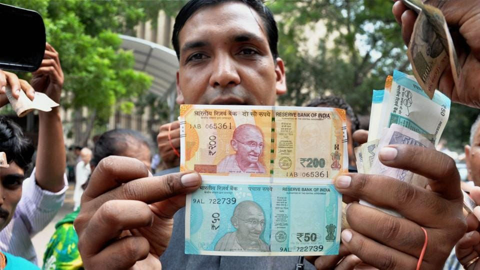 A man shows new currency notes of ₹200 and ₹50 outside the Reserve Bank of India in New Delhi.This is the first time that ₹200 banknotes have been introduced in India. From the violence that erupted with Ram Rahim's verdict to Ganesh Chaturthi, a selection of best photos of the week across the country. (PTI)