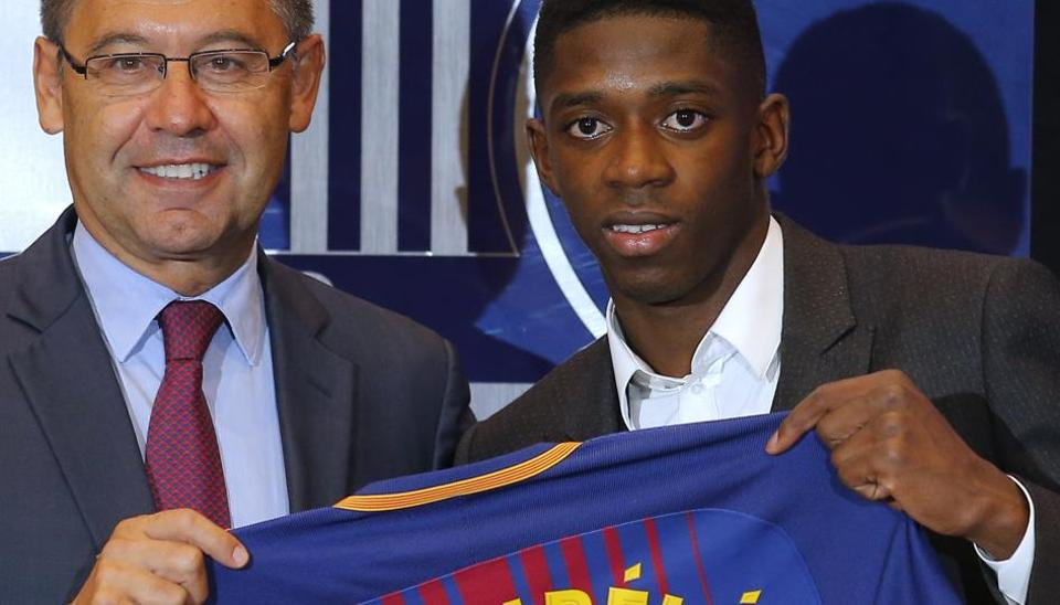 FC Barcelona's new signing Ousmane Dembele (R) and Barca president Josep Maria Bartomeu during the official presentation at the Camp Nou stadium in Barcelona on Monday.