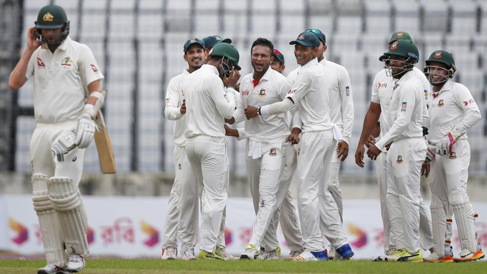 Shakib Al Hasan celebrates with his Bangladesh teammates after the dismissal of Australia's Nathan Lyon on Day 1 of the first Test in Dhaka on Sunday.