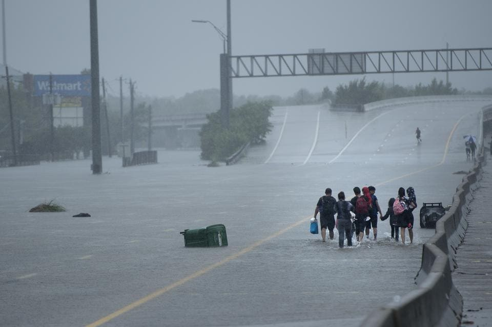 Evacuated residents walk on an overpass during the storm in Houston, Texas on August 27, 2017.