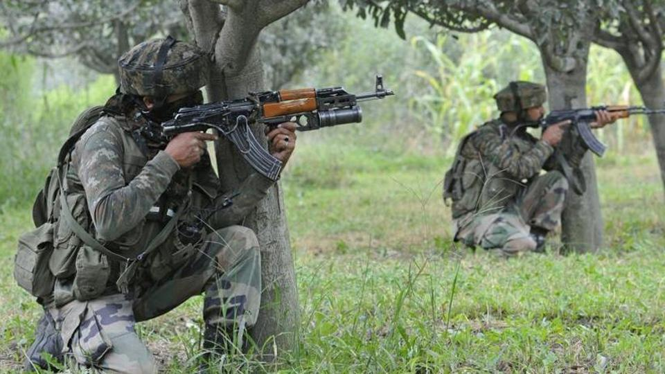 Indian Army soldiers take position near the site of the gunfight at the district police lines in Pulwama, about 30km south of Srinagar.