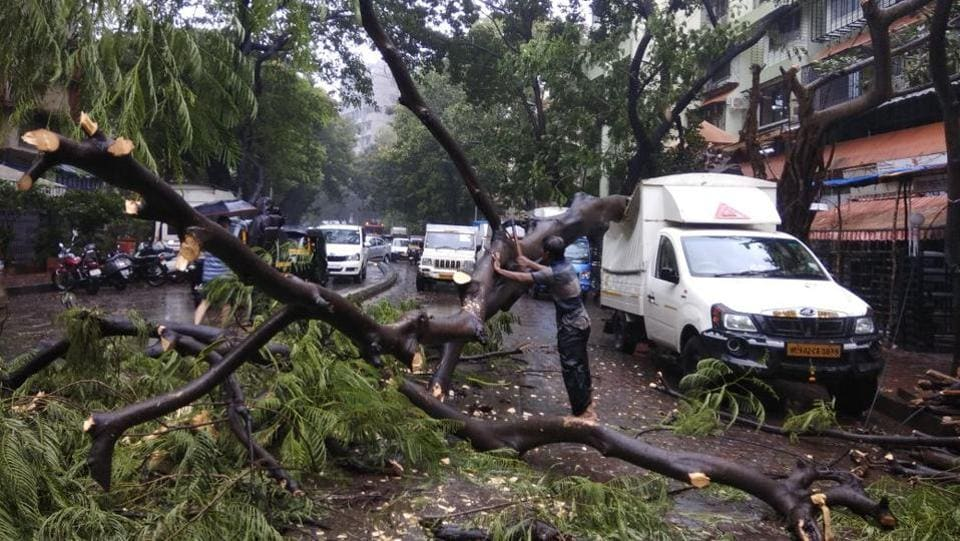 Apart from heavy rains, there were also reports of tree falls trickling in, and four people injured after an iron frame for posters fell, at the VP road area. The injured had been shifted to Saifee hospital in Mumbai.The weather condition is likely to affect the city adversely as there are restrictions at various roads in eastern suburbs and south Mumbai owing to Ganeshotsav. (Satyabrata Tripathi / HT Photo)