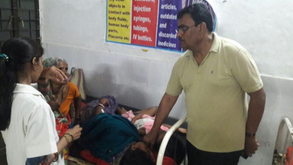 Villagers undergoing treatment at the Forbesganj referral hospital in Bihar's Araria district on Monday. (HT photo)