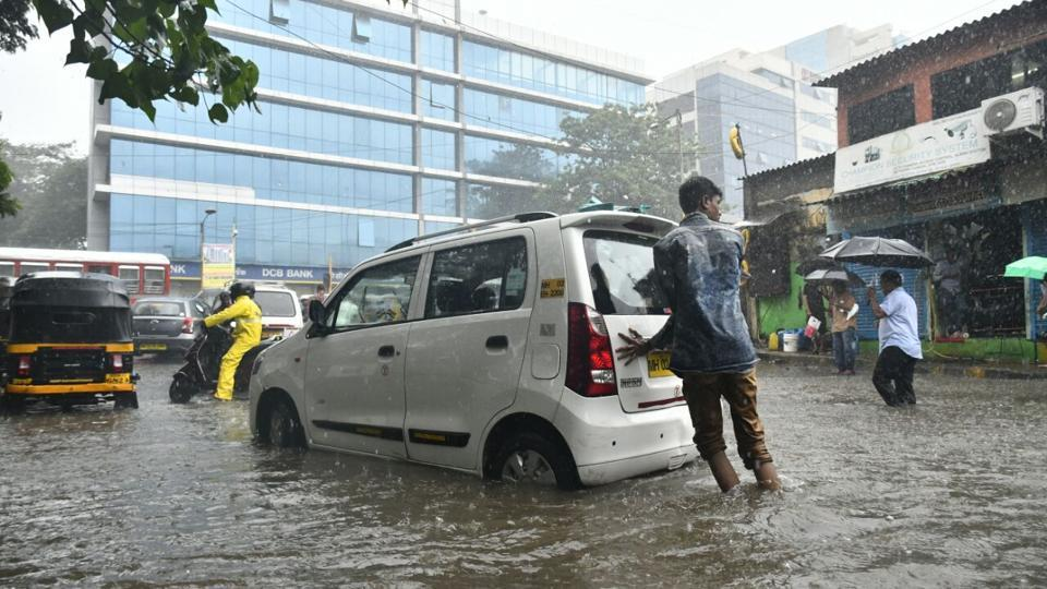 Image result for Mumbai Rains: Heavy showers lash the city, expect traffic and train delays