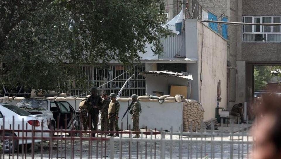 Afghan security personnel arrive at the site of an explosion near a bank in Kabul, Afghanistan, Tuesday, Aug. 29, 2017.