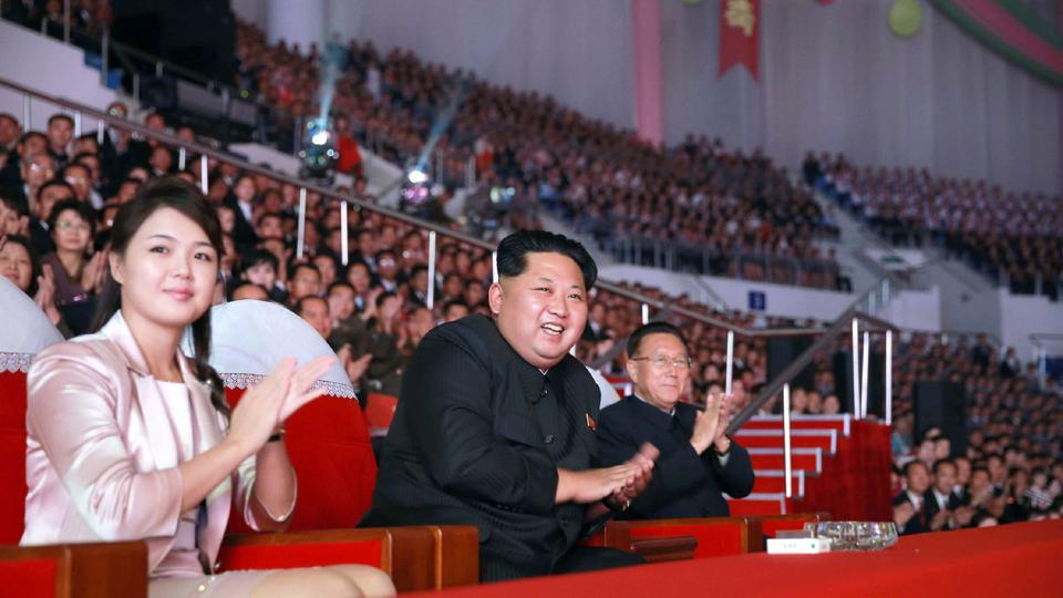 (FILES) This undated file picture released by North Korea's official Korean Central News Agency (KCNA) on October 19, 2015 shows North Korean leader Kim Jong-Un (C), accompanied by his wife Ri Sol-Ju (L) in Pyongyang.
